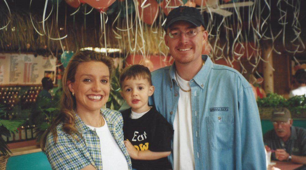 Blake and Kippi holding their son, Zyler